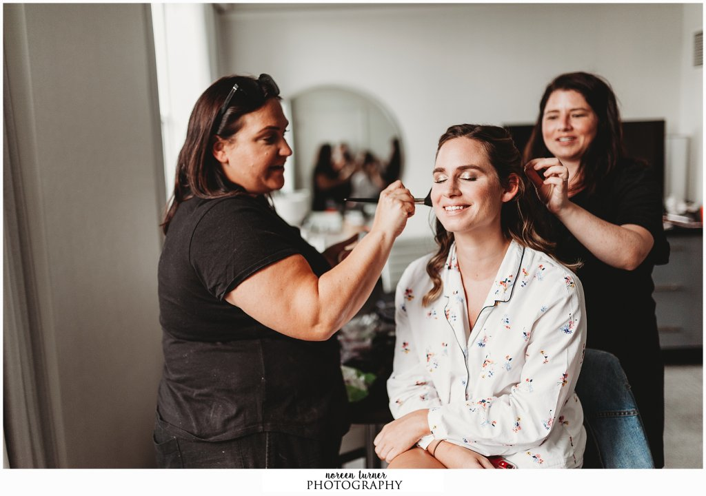 Bridal prep at Loews Hotel Philadelphia for a fall Reading Terminal Market wedding