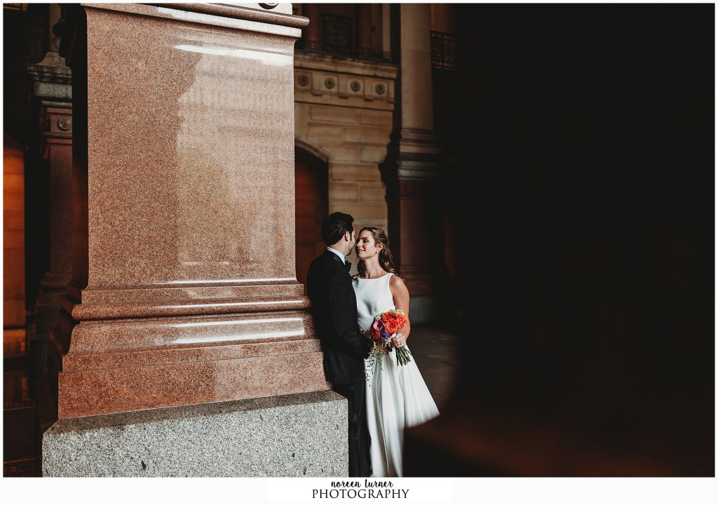 Bride and groom portraits at Philadelphia city hall for a fall Reading Terminal Market wedding